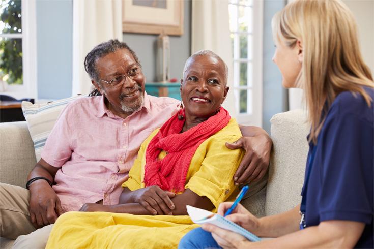 Female carer advising couple